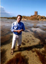 Gerard Le Claire in a blue shirt on the beach in Jersey